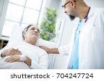 doctor talking to patient in...   Shutterstock . vector #704247724