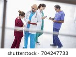 medical team discussing in...   Shutterstock . vector #704247733