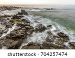 sunrise at wilches beach ... | Shutterstock . vector #704257474