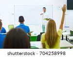 high school students answering... | Shutterstock . vector #704258998