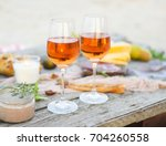 beach picnic table with rose... | Shutterstock . vector #704260558