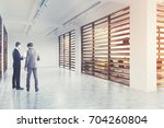 company lobby interior with... | Shutterstock . vector #704260804