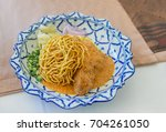 curried noodle soup  khao soi ... | Shutterstock . vector #704261050