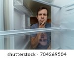 hungry man is looking for food... | Shutterstock . vector #704269504