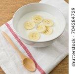 bowl of homemade yoghurt...   Shutterstock . vector #704284729
