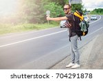 handsome young man hitchhiker... | Shutterstock . vector #704291878