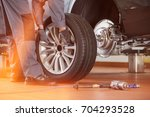 low section of male mechanic... | Shutterstock . vector #704293528