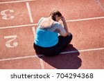 unlucky woman sitting on... | Shutterstock . vector #704294368