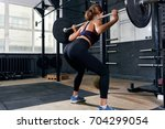 back view of  strong young... | Shutterstock . vector #704299054