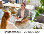confident owner of cafe... | Shutterstock . vector #704302120