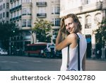 beautiful and attractive blonde ... | Shutterstock . vector #704302780