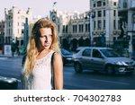 beautiful and attractive blonde ... | Shutterstock . vector #704302783