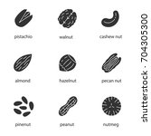 nuts types glyph icons set.... | Shutterstock .eps vector #704305300
