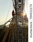 metal constructions. ferris... | Shutterstock . vector #704312173