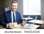 happy young specialist with... | Shutterstock . vector #704313310