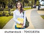 attractive girl in the park.... | Shutterstock . vector #704318356