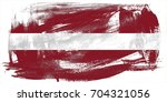 latvia flag grunge background.... | Shutterstock . vector #704321056