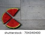 pieces of watermelon on the... | Shutterstock . vector #704340400