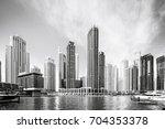 dramatic skyline of luxury... | Shutterstock . vector #704353378