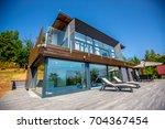 luxurious villa exterior   Shutterstock . vector #704367454