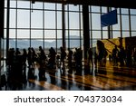 silhouette crowd people waiting ... | Shutterstock . vector #704373034