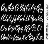 hand drawn dry brush font.... | Shutterstock .eps vector #704388160