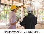 two business man construction... | Shutterstock . vector #704392348