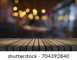 image of wooden table in front... | Shutterstock . vector #704392840