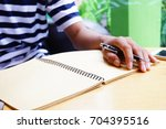 Small photo of The man with notebook on the table