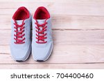 gray sneakers running with red... | Shutterstock . vector #704400460