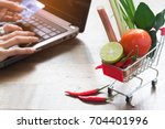 shopping cart with full of... | Shutterstock . vector #704401996