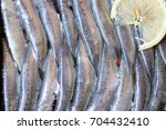 raw filleted sardines with a... | Shutterstock . vector #704432410