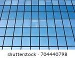 blue windows of a modern office ...   Shutterstock . vector #704440798