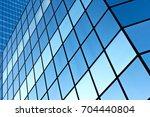 blue windows of a modern office ...   Shutterstock . vector #704440804