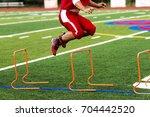 a football player is jumping... | Shutterstock . vector #704442520