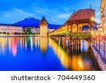 lucerne  switzerland. historic... | Shutterstock . vector #704449360