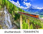 zermatt  switzerland.... | Shutterstock . vector #704449474