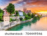 Basel, Switzerland. Old town with red stone Munster cathedral on the Rhine river.