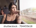 young woman portrait inside a... | Shutterstock . vector #704455618