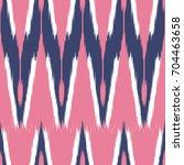 ikat seamless pattern  as cloth ...   Shutterstock .eps vector #704463658