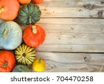 pumpkins and squashes on wooden ... | Shutterstock . vector #704470258