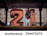 21   old neon light numbers  ... | Shutterstock . vector #704473273