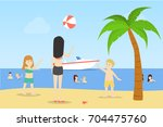playing with ball at the beach. ... | Shutterstock .eps vector #704475760