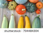 Pumpkins And Squashes On Woode...