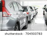 new japanese cars  row  parked... | Shutterstock . vector #704503783