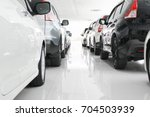 a row of new cars parked at a... | Shutterstock . vector #704503939