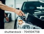 specialist prepares car for... | Shutterstock . vector #704504758