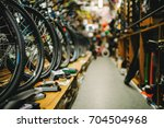 bicycle shop  rows of new bikes ... | Shutterstock . vector #704504968