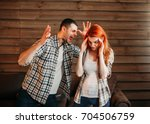 young couple in conflict  man... | Shutterstock . vector #704506759