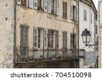 old balcony in entrevaux a... | Shutterstock . vector #704510098